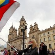 People demonstrate on the street as Colombia