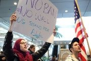 People gather to protest against U.S. President Donald Trump's executive order travel ban at LAX.