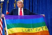 Donald Trump holds up a rainbow flag with