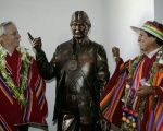 Bolivia's President Evo Morales (R) and Vice President Alvaro Garcia Linera (L) pose with a statue of Morales at the country's new museum.