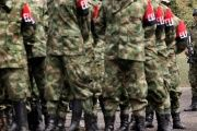 A group of demobilized ELN rebels walks in Cali, Colombia, July 16, 2013.