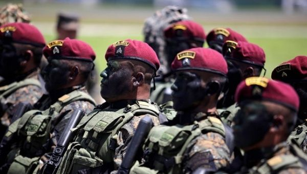 Kaibiles, members of an elite group of the Guatemalan army, take part in a military parade during Army Day celebrations, at the Air Force headquarters in Guatemala City, Guatemala, July 3, 2016.