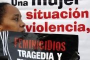 Woman protesting against femicide in Latin America.