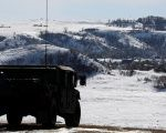 A North Dakota National Guard vehicle idles on the outskirts of the Dakota Access pipeline protest camp near Cannon Ball, North Dakota, U.S.
