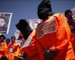 Former Guantanamo prison detainees wear black hoods during a protest to demand the release of Yemeni detainees from Guantanamo.