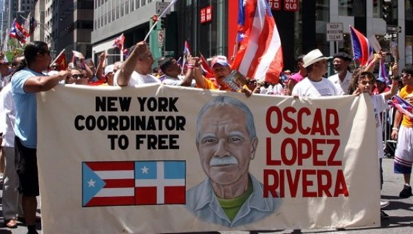 A group of supporters march to call for Oscar Lopez Rivera