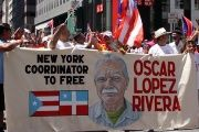 A group of supporters march to call for Oscar Lopez Rivera's freedom in New York, June 8, 2017.