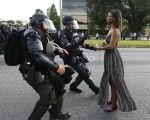 A demonstrator protesting the shooting death of Alton Sterling is detained by police near in Baton Rouge, Louisiana, U.S. July 9, 2016.