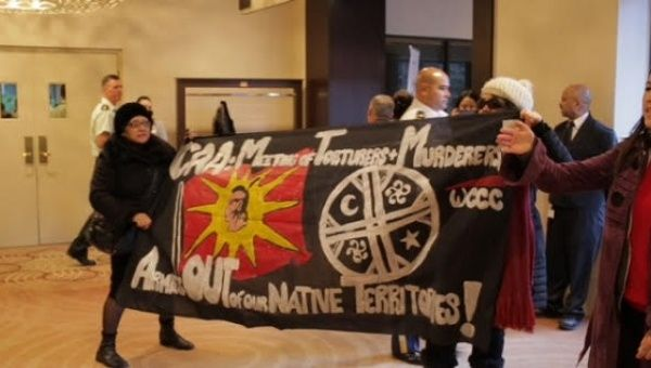 Activists disrupt the Conference of American Armies in a downtown Toronto hotel.