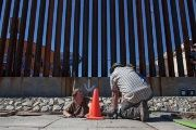 Workers blocking a tunnel dug under a portion the U.S.-Mexico border wall in Arizona. May 22, 2014