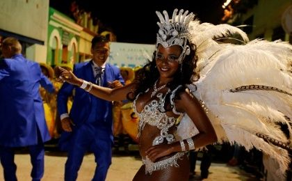 Members of a Uruguayan carnival group, dance during the Llamadas parade, a street fiesta with traditional Afro-Uruguayan roots, in Montevideo, Feb. 10, 2017.