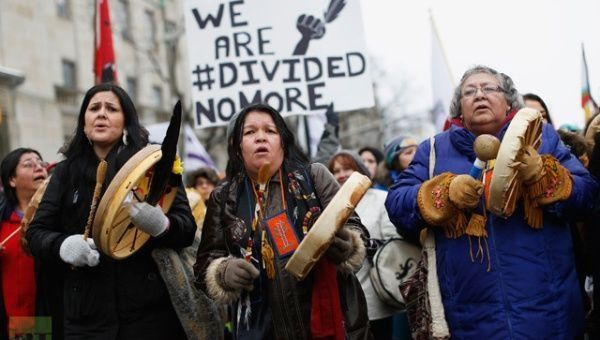 Indigenous protesters march before the start of a meeting between chiefs and Prime Minister Stephen Harper in Ottawa January 11, 2013.