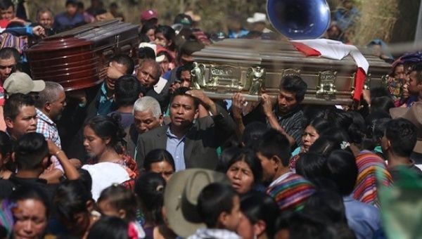 People attend the funeral of two murdered boys in San Juan Sacatepequez, Guatemala, Feb. 14, 2017.