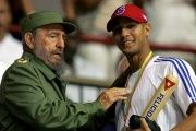 Late Cuban President Fidel Castro hands out a baseball bat to Cuban player Yulieski Gourriel in Havana. March 21, 2006.