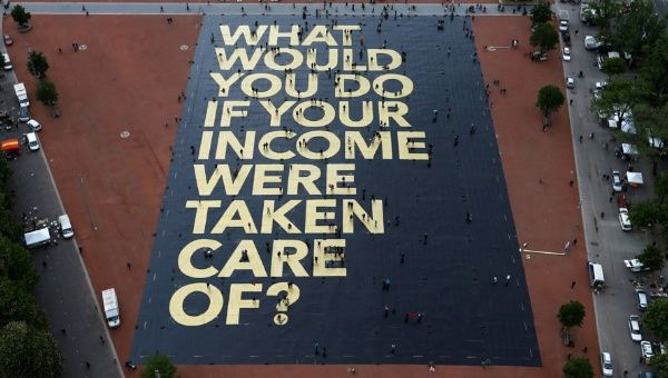 A large poster in a square in Geneva, Switzerland, promoting the idea of a universal basic income