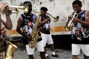 Revellers play music in the annual carnival block party known as