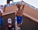 Inmates are seen on a roof during an uprising at Alcacuz prison in Natal, Rio Grande do Norte state, Brazil.