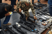 Bolivian police discover a large cargo of military weapons from the United States.