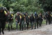 FARC rebels marching towards a designated