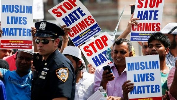 People rally against hate crimes.