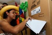 Diane Rodriguez, a member of the Ecuadorean transgender community, casts her vote during the presidential election in Guayaquil, Ecuador Feb. 19, 2017.