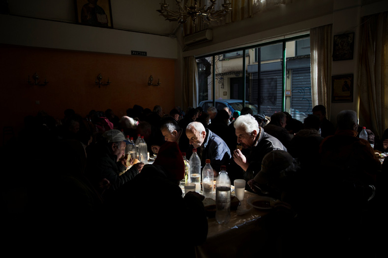 People eat at a soup kitchen run by the Orthodox church in Athens, Greece, Feb. 15, 2017.