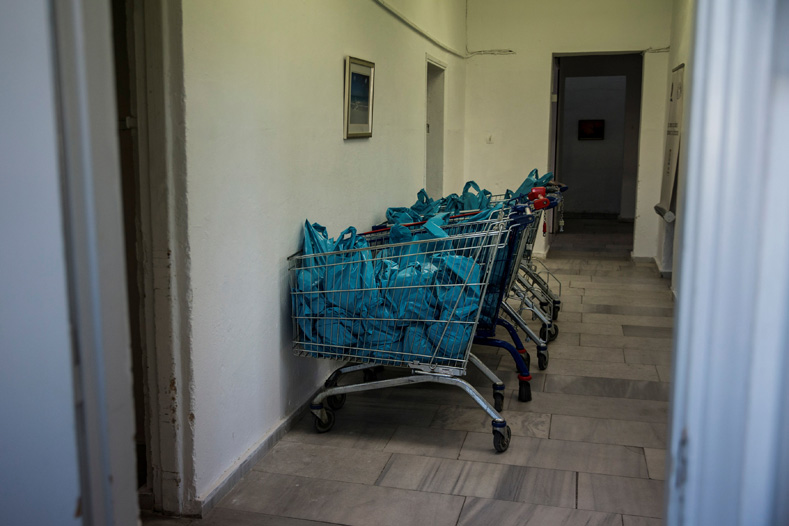 Shopping carts full of plastic bags containing food supplies for impoverished Greeks are seen at an Athens Municipality-run centre in Athens, Greece, Feb. 17, 2017.