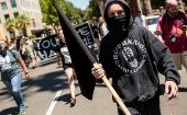 Anti-fascist counter-protesters parade through Sacramento.