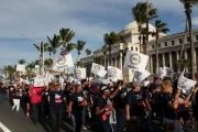 Members of labor unions march past the capitol building during a protest in San Juan, Puerto Rico.