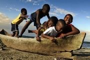 Children from Garifuna community in Roatan, Honduras, play on the beach, March 17, 2009.
