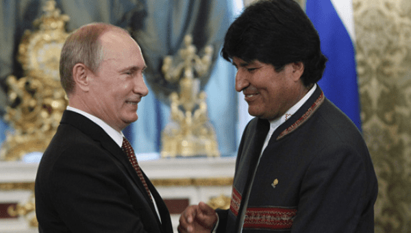 Russian President Vladimir Putin greets Bolivian President Evo Morales during a 2013 meeting at the Kremlin.