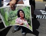 An activist holds a photos of slain environmental rights activist Berta Caceres during a march in Managua, Nicaragua, March 8, 2016.