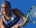 Monica Puig of Puerto Rico returns a ball to Francesca Schiavone of Italy during their Mexico Tennis Open match in Acapulco, Guerrero, Mexico, Feb. 28, 2017.