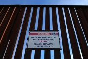 A Donald Trump campaign sticker is shown attached to a U.S. Customs sign on the border fence between Mexico and the United States near Calexico, California.