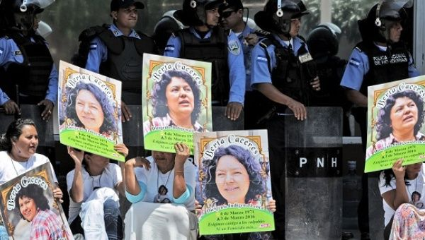 Human rights activists take part in a protest to claim justice after the murder Berta Caceres, Tegucigalpa, March 17, 2016.