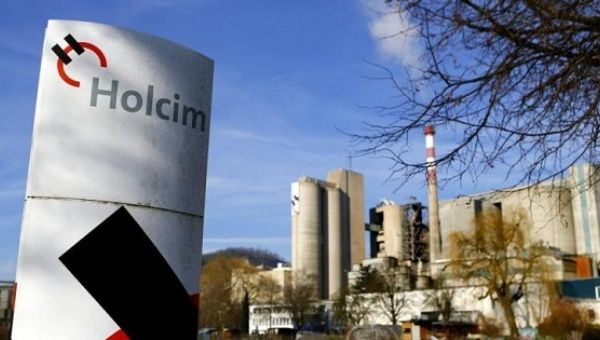 A Holcim logo is pictured in front of the cement works in Eclepens near Lausanne Feb. 25, 2014.