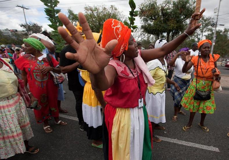 A group of Garifuna women take part in the march, lambasting the state for failing to protect Caceres and other environmental activists like her.