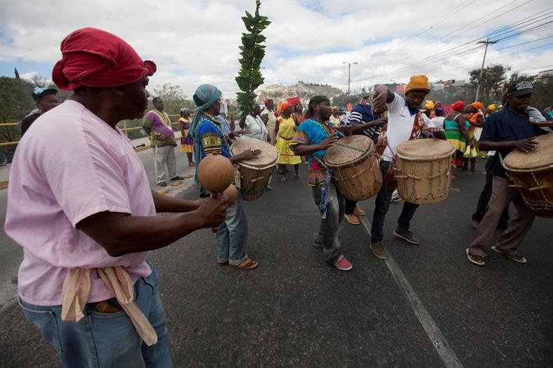 Garifuna women play drums at the protest together with members of the Lenca Indigenous community.