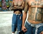 Members of the Barrio 18 gang show their tattoos in the National Penitentiary in Tamara, near the Honduran capital of Tegucigalpa.