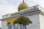 The Gurdwara Singh Sabha shows banners clarifying that it is a Sikh temple. Sikhs are often confused for Muslims after Islam-linked terror events.