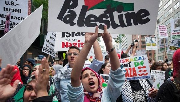 "Protesters shout ""Free Palestine"" during a march in midtown Manhattan, New York, July 9, 2014."
