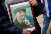 A supporter holds an image of former Cuban leader Fidel Castro at a tribute in Malaga, southern Spain, Dec. 4, 2016.