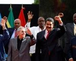 Raul Castro stands next to Latin American and Caribbean leaders during an ALBA alliance summit in Caracas, Venezuela.
