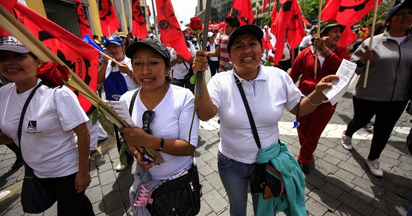 Ecuadorean women march with unions on International Workers' Day in the capital city Quito, May 1, 2016.