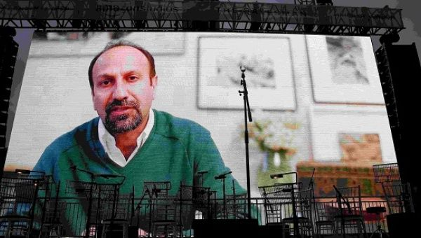"Iranian director Asghar Farhadi speaks via a video link at the screening of the film ""The Salesman"" in Trafalgar Square in London n protest of Trump"