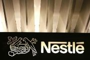 The Nestle logo is pictured on the company headquarters entrance building in Vevey, Switzerland February 18, 2016.