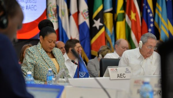 Newly-sworn in ACS Secretary General Dr. June Soomer sits next to Cuban President Raul Castro during her opening remarks at the 22nd Ordinary Meeting of the ACS.
