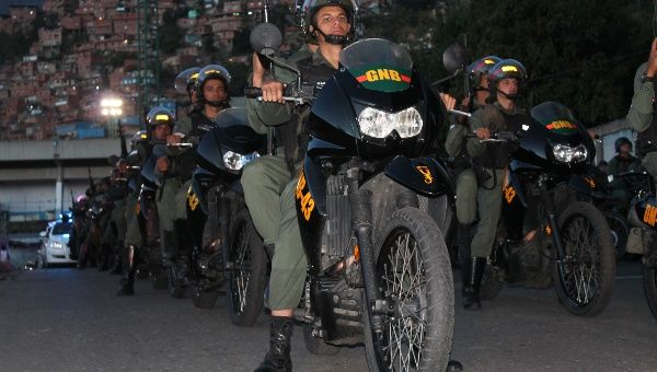 Bolivarian National Guard officers start patrols to reinforce security in Petare.