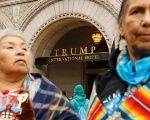 Indigenous women take part in a rally in front of the Trump International Hotel to protest the Dakota Access and Keystone XL pipelines.