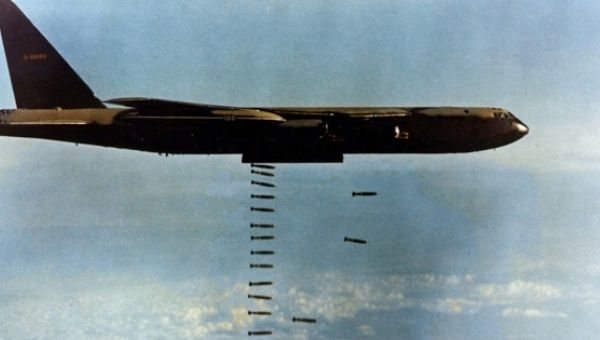 A U.S. Air Force Boeing Stratofortress dropping bombs over Vietnam.